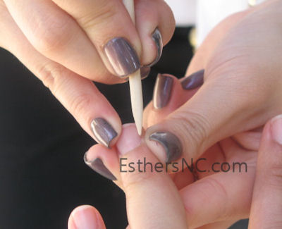 clean the nails from shellac residue with wood stick